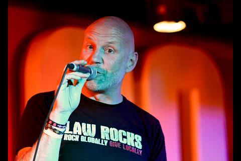 Compere Damian Hickman at Law Rocks! 100 Club